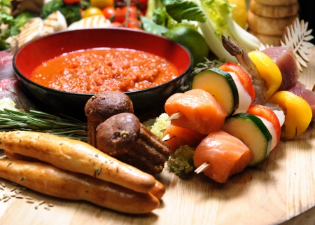 Abundance of raw food on a wooden board photo
