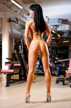 female bodybuilder: Athletic beautiful woman posing in the fitness club Stock Photo