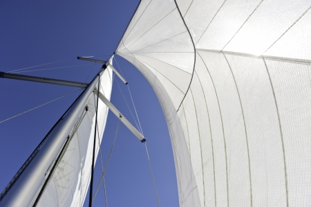 Sails and mast over blue sky background photo