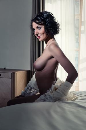erotic breast: Beautiful naked brunette indoors