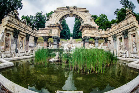 Old fountain in park of Schonbrunn Palace in Vienna  Austria photo