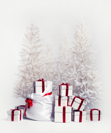 Christmas trees with heap of gift boxes over white background Stock Photo - 14973891