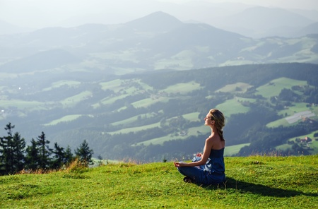 silent: Young woman meditating outdoors Stock Photo