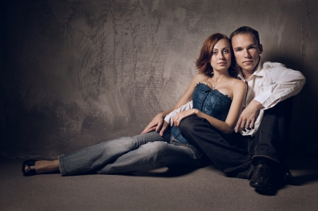 Beautiful young couple in love indoor, studio shot photo