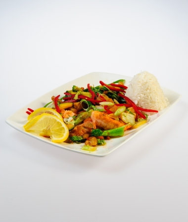 Dish with fried salmon, rice and vegetables photo