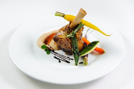 roast lamb: Juicy meat with vegetables on a plate close-up