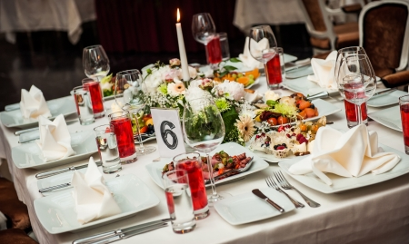 candle light dinner: Luxury banquet table setting at restaurant