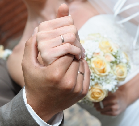 wedding accessories: Hands of the bride and groom close-up Stock Photo