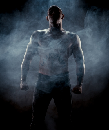 Silhouette of muscular man Stock Photo - 16294884