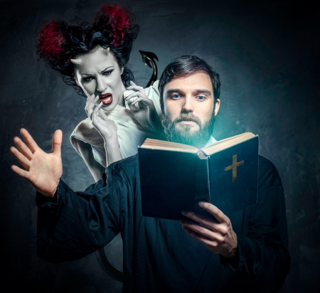 priest's ritual robes: Priest evicting demons, conceptual photo Stock Photo