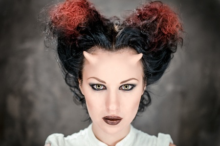 Portrait of beautiful horned woman with bright makeup, conceptual photo photo