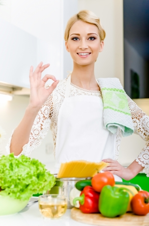 Young woman cooking. Healthy Food. Dieting Concept. Healthy Lifestyle. Cooking At Home.  Stock Photo - 17398847