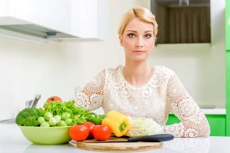 Young woman in the kitchen.Healthy Food. Dieting Concept. Healthy Lifestyle. Cooking At Home. Stock Photo - 17480351