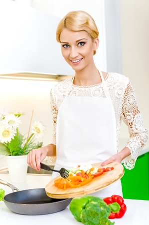 Young woman cooking. Healthy Food. Dieting Concept. Healthy Lifestyle. Cooking At Home. Stock Photo - 17482864