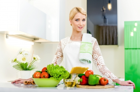 Young woman in the kitchen.Healthy Food. Dieting Concept. Healthy Lifestyle. Cooking At Home. Stock Photo - 17482868