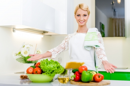 Young woman in the kitchen.Healthy Food. Dieting Concept. Healthy Lifestyle. Cooking At Home. Stock Photo - 17482863