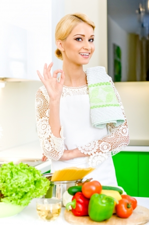 Young woman in the kitchen.Healthy Food. Dieting Concept. Healthy Lifestyle. Cooking At Home. Stock Photo - 17482869