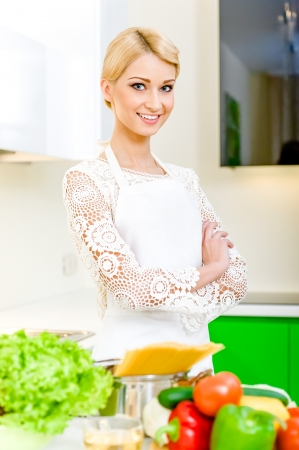 Young woman in the kitchen.Healthy Food. Dieting Concept. Healthy Lifestyle. Cooking At Home. Stock Photo - 17482867