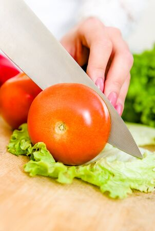 Woman cutting vegetables for a salad Stock Photo - 17482865