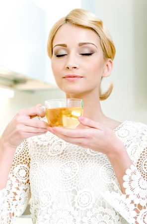 Portrait of beautiful girl drinking tea photo