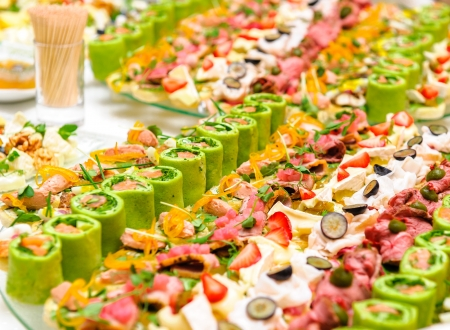 Trays with various delicious appetizer photo