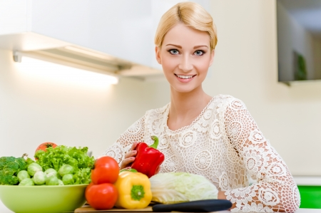Young woman in the kitchen.Healthy Vegetarian Food. Dieting Concept. Healthy Lifestyle. Cooking At Home. Stock Photo - 17655676