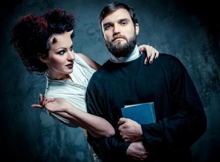 exorcism: Portrait of priest and devil