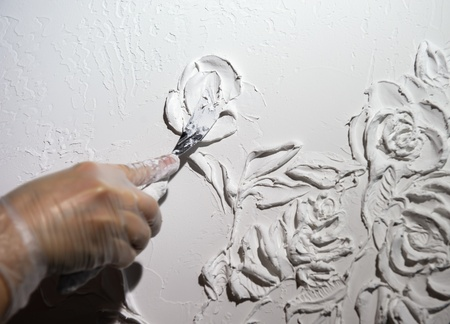 gypsum: Artists hand and white flowers pattern