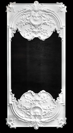 bas: White bas rlief frame over black wall