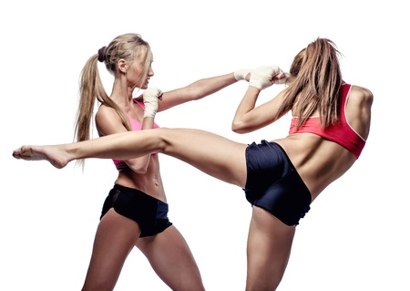 female fighter: Two attractive athletic girls fighting, isolated on  white background Stock Photo