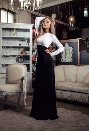 styled interior: Young female posing in luxury vintage interior