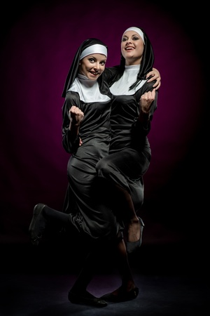 Two funny nuns indoors Stock Photo - 18887154