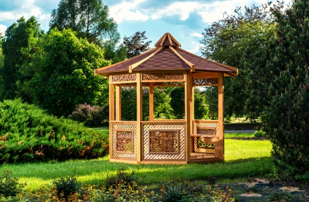 Outdoor wooden gazebo over summer landscape background photo