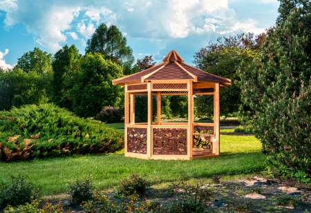 arbor: Outdoor wooden gazebo over summer landscape background