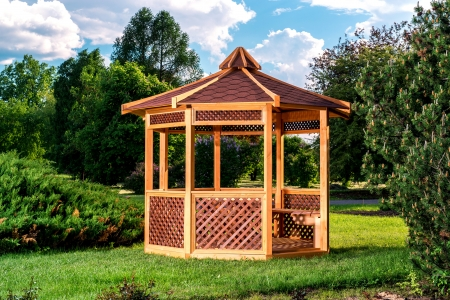summerhouse: Outdoor wooden gazebo over summer landscape background