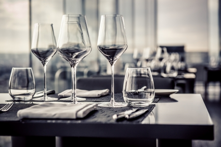 restaurant setting: Empty glasses in restaurant, black and white photo