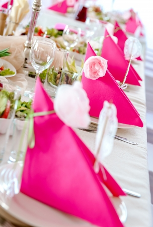 Wedding Table Decorations in pink and white colors, napkins close-up Stock Photo