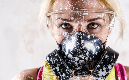 dust mask: Portrait of a woman with protective filter mask Stock Photo