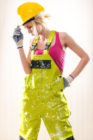 Female construction worker posing indoors photo