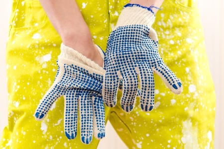protective workwear: Female construction worker in coverall and protective gloves Stock Photo