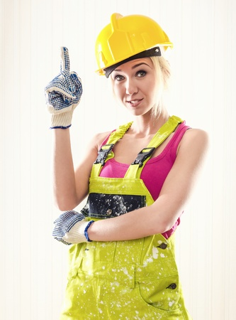 coverall: Female wearing coverall and hard hat posing indoors