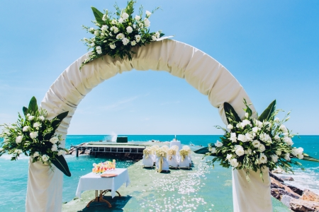wedding chairs: Wedding arch and wedding chairs on the empty beach