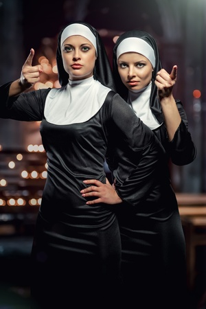 nuns: Attractive young nuns posing in the church