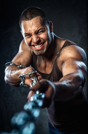 Muscular man pulling the chain Stock Photo - 20834466