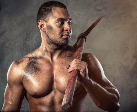 Muscular man holding pickaxe Stock Photo - 20834469