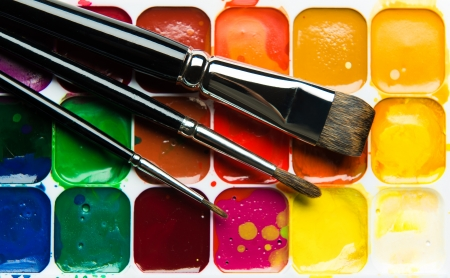 paintbox: Watercolor paintbox and paintbrushes close-up Stock Photo