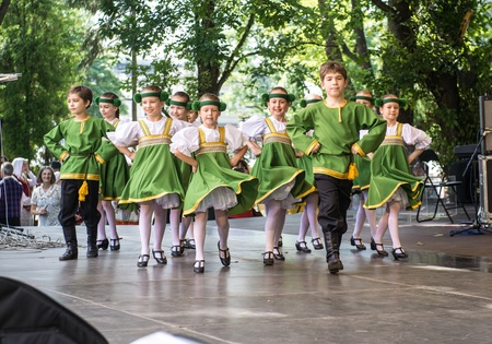 latvia girls: RIGA, LATVIA - JULY 03:  Dancing childrens in national costumes at the Latvian National Song and Dance Festival on July 03, 2013. Holiday was hold from 30th June 2013 till the 7th July 2013. The Song and Dance Celebration has also been included in the UNE