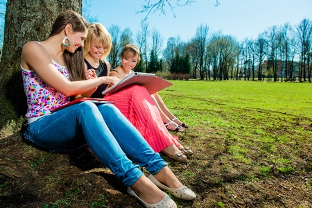 classbook: Group of students studying outdoors
