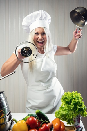 Angry and stressed out woman cook  photo