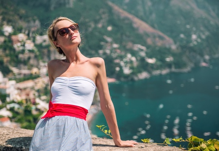 positano: Beautiful young woman and view of Positano, Italy Stock Photo